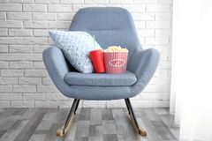 Rocking chair with popcorn and drink in home cinema. Watching movie stock images