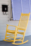 Rocking Chair on Porch. A Yellow Rocking Chair on a Porch Stock Photo