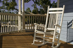 Rocking Chair on Porch. White rocking chair on historic porch Stock Photos