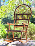 Rocking chair on porch. Of country house on background of summer garden Stock Image
