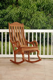 Rocking Chair On Porch. Simple wooden rocking chair on porch Royalty Free Stock Images
