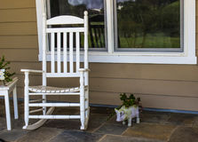 Rocking Chair On Porch. White Rocking Chair On House Porch Stock Images