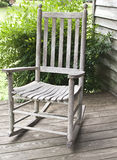 Rocking chair on side of porch Stock Photos