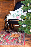 Rocking chair, slippers with fur carpet. Stock Photography
