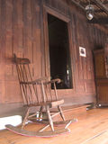 Rocking chair and teak house Stock Photos