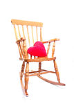 Rocking Chair With Red Heart Pillow Royalty Free Stock Images