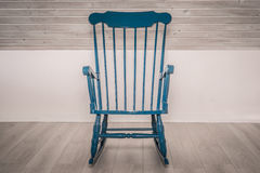 Rocking chair on wooden floor Stock Image