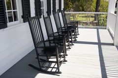 Rocking Chairs. Four Rocking Chairs on Front Porch Stock Image