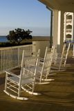Rocking chairs. Aon the sunny porch Stock Images