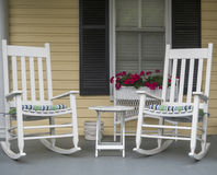 Rocking Chairs. A classic American scene of rocking chairs on porch with small table Stock Image