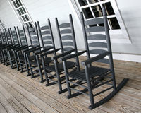Rocking chairs lined up on the porch Stock Image