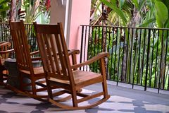 Rocking Chairs on a Patio Royalty Free Stock Photos