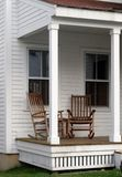 Rocking Chairs on the Porch. Two rocking chairs on a New England back porch royalty free stock photos