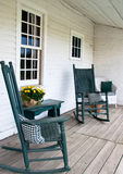 Rocking chairs on the porch of an old building Stock Photography