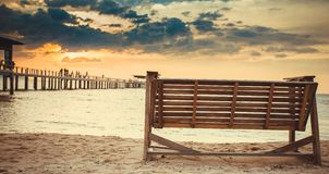 Rocking chairs on the Sand at beach front with blue sky Sunset Royalty Free Stock Image
