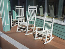 Rocking chairs on store sidewalk Royalty Free Stock Images