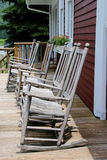 Rocking Chairs. The rocking chairs were all lined up waiting for people to sit and relax Royalty Free Stock Photos