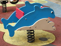 Rocking Dolphin. Rocking spring dolphin at children's playground Stock Photography