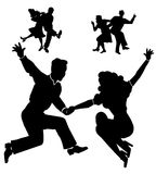 Rocking down the house swing style. Dancers from fifties rea dancing swing and jive in silhouette form Stock Photos