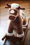 Rocking horse. Wooden rocking horse in a childs nursery Royalty Free Stock Image