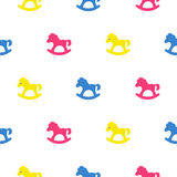 Rocking horse blue, pink and yellow kid pattern. Stock Image