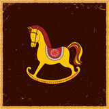 Rocking horse on brown background. Stock Images