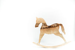 Rocking Horse carved on natural wood isolated on white backgroun. D Stock Images