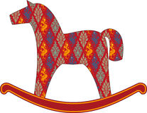 Rocking horse. Childrens rocking horse, covered with a pattern Stock Photos