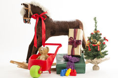 Rocking horse with christmas gift Royalty Free Stock Photography