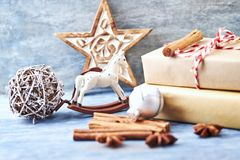 Rocking horse, Christmas star, bauble and Christmas presents stock photo