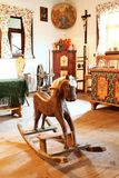 Rocking horse in cottage Stock Image