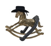 Rocking Horse with Cowboy Hat and Horseshoe Royalty Free Stock Photos