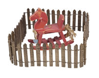Rocking Horse Enclosed in Picket Fence Royalty Free Stock Photography