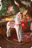 Christmas rocking Horse. Rocking horse with gift package, xmas tree and toys.A childhood christmas toys holidays vintage Royalty Free Stock Image