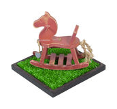 Rocking Horse in a Grass Field Stock Images