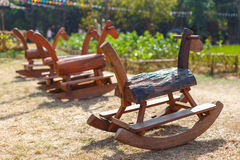 Rocking horse is handmade toys in park, Children like to play fun Stock Image