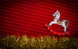 Rocking-horse over christmas decoration background Royalty Free Stock Photos