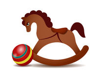 Rocking horse and a red ball Stock Photography
