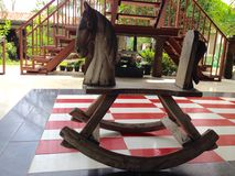 Rocking horse on red,white and black tile Stock Photography