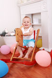 Rocking horse ride. Cute smilling boy enjoy his rocking horse ride Stock Photos