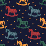 Rocking Horse Silhouette. Seamless Pattern With Rocking Horses On Dark Blue Background. Stock Photography