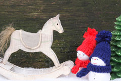 Rocking horse and snowmen Royalty Free Stock Image