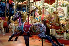 Rocking horses in the Merry go round,  Jubilee Gardens South Bank London England - Stock Images