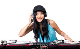 Rocking the party. A young Asian girl with a big smile DJing on turntables Stock Image