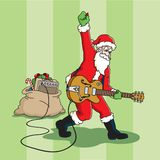 Rocking Santa Claus. Santa plays a rock and roll electric guitar through an amplifier in his bag of toys Stock Photography