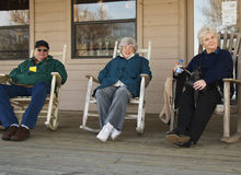 Rocking Seniors. Three senior people are really having a good time just rocking on the front porch Stock Image
