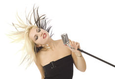 Rocking singer and microphone wild hair Royalty Free Stock Images