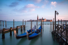 Rocking the Venetian gondolas against San Giorgio Maggiore Church on the Grand Canal Royalty Free Stock Image