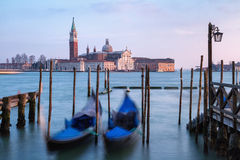 Rocking the Venetian gondolas  against San Giorgio Maggiore Church on the Grand Canal Stock Image
