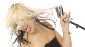 Rocking wild hair singer and microphone royalty free stock photography